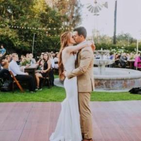 Couple dances at a wedding on SnapLock Plus Dark Maple dance floor