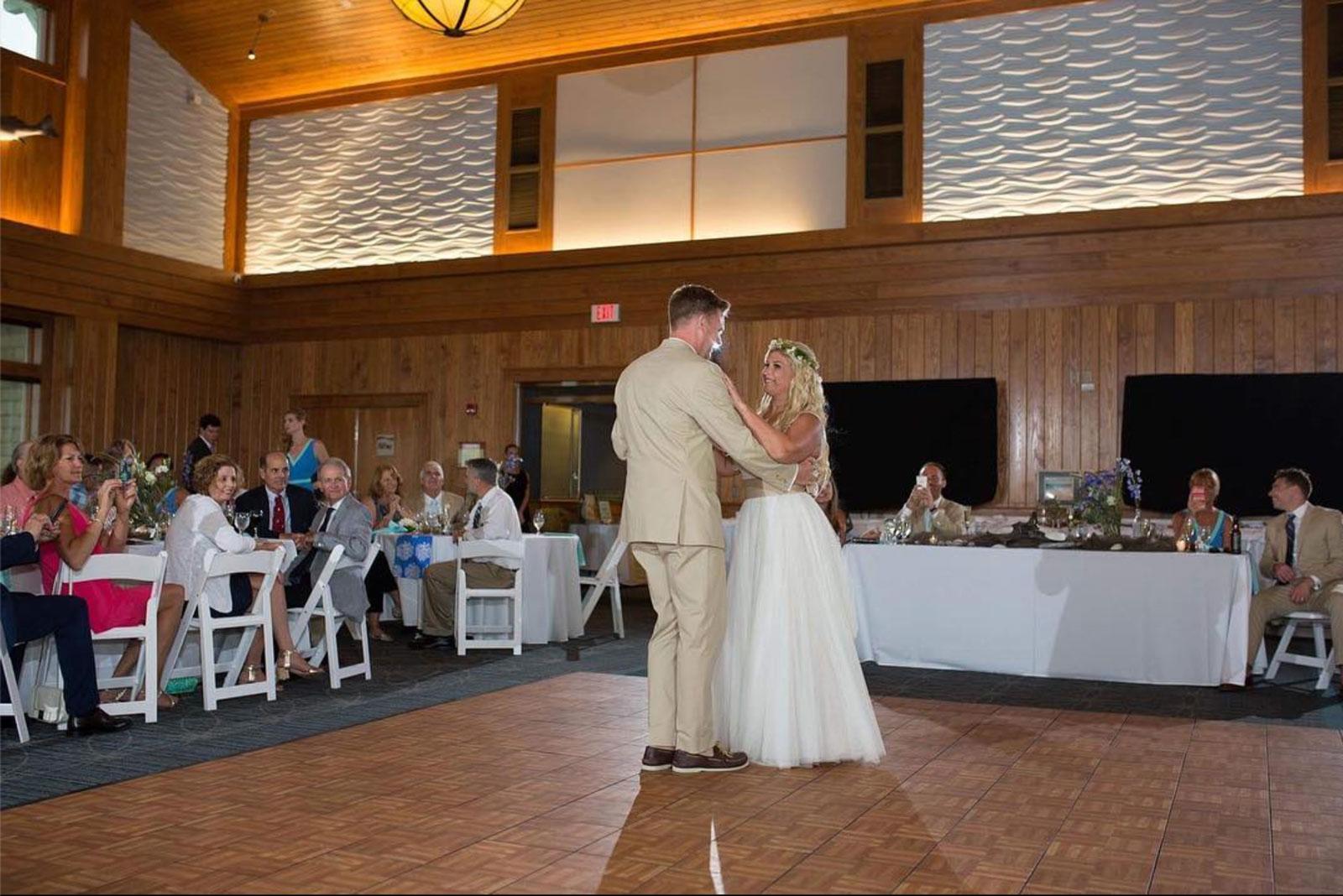Oak style portable wedding dance floor inside a building