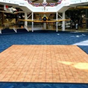 Oak style dance floor inside an airplane museum