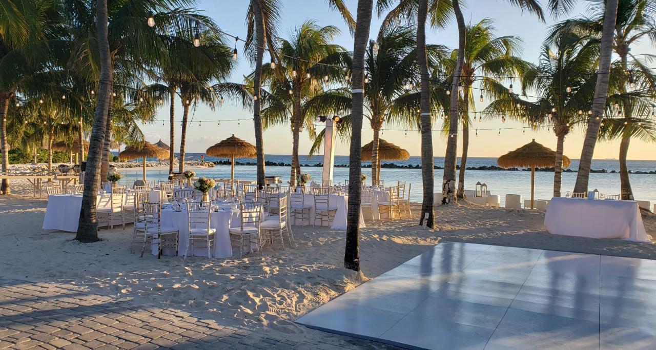 Slate white style dance floor at a beach wedding