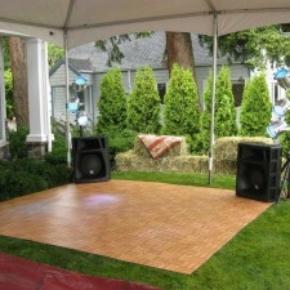 oak portable dance floor on grass