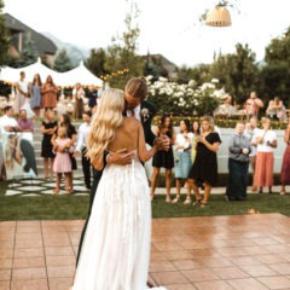 Couple dancing on Teak style wedding dance floor outdoors